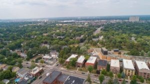 drone view of grand avenue with many brick apartment buildings